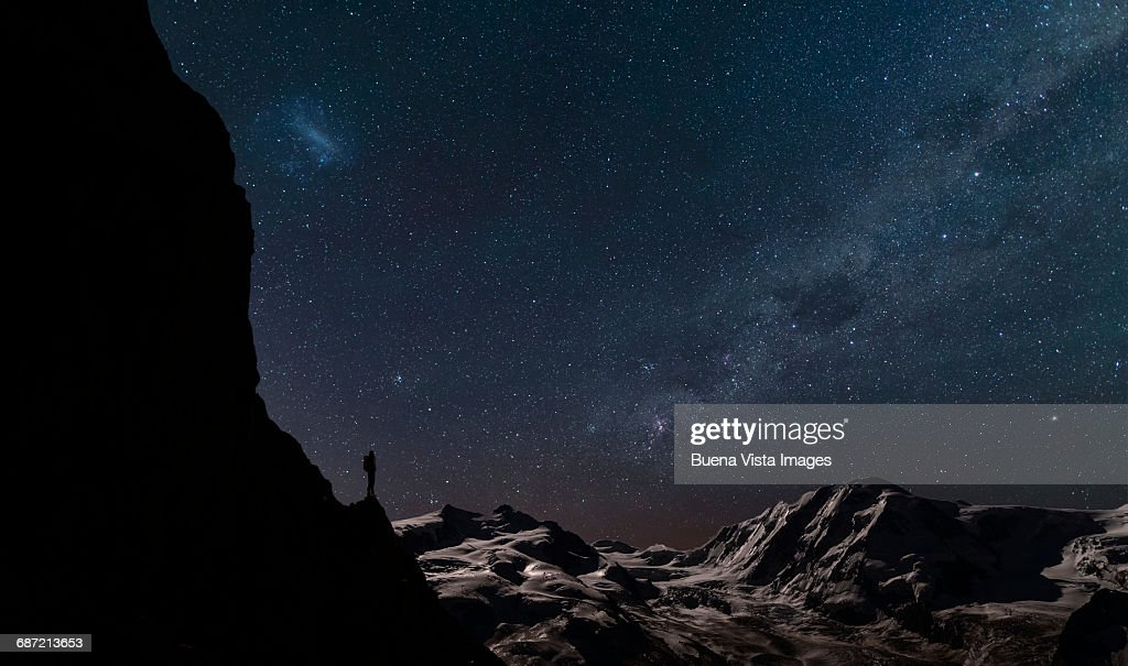 Lone climber watching stars in the sky : Stock Photo