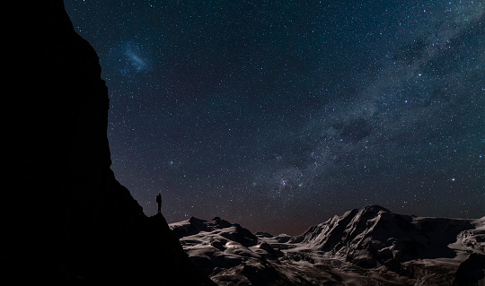Lone climber watching stars in the sky - gettyimageskorea