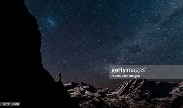 Lone climber watching stars in the sky