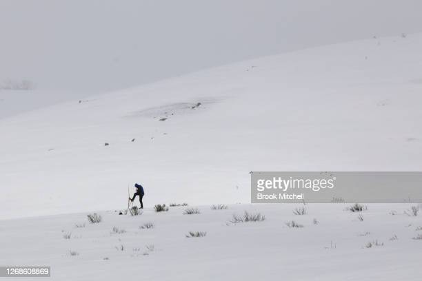 A lone cross country skier braves the blizzard conditions inside the Kosciuszko National Park on August 23 2020 in the Kosciuszko National Park...