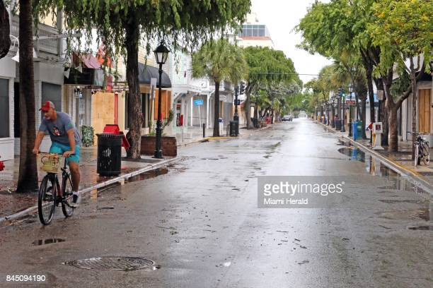 Lone cyclist rides along deserted Duval Street in Key West, Fla., on Saturday, Sept. 9, 2017. Hurricane Irma is approaching the Florida Keys and some...
