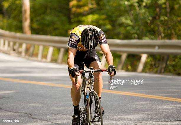 Lone Cyclist Struggles up a Steep Slope