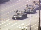 Lone demonstrator stands down a column of tanks june 5 1989 at the picture id1374461?s=170x170