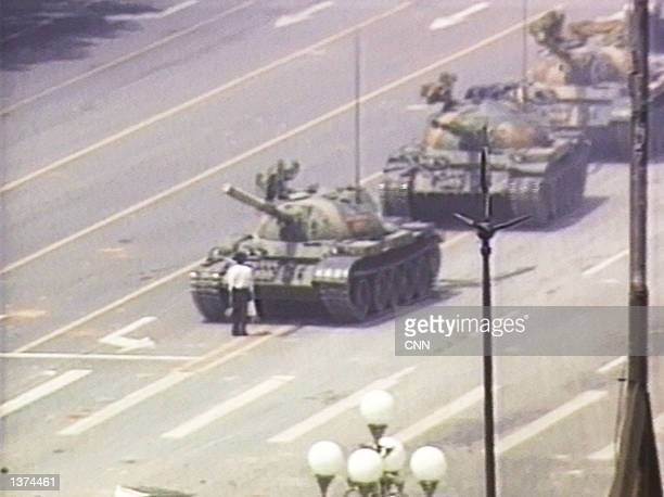 A lone demonstrator stands down a column of tanks June 5 1989 at the entrance to Tiananmen Square in Beijing The incident took place on the morning...