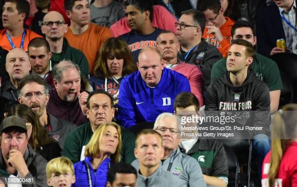 MINNEAPOLIS MN A lone Duke fans sits among a sea of Texas Tech Virgina Auburn and Michigan State fans in the second half of a semifinal game of the...