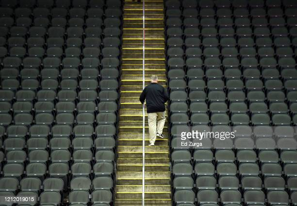 A lone fan exits Sprint Center after it was announced that the Big 12 basketball tournament had been cancelled due to growing concerns with the...