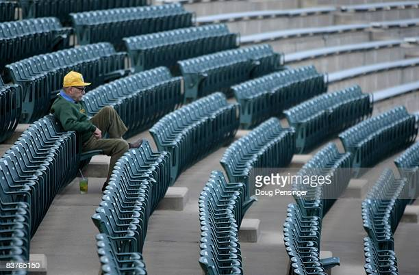 A lone fan takes his seat as the Brigham Young Cougars and the Colorado State Rams take the field to warm up prior to the game at Sonny Lubick Field...