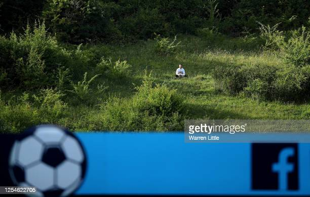 Lone fan watches from the hillside during the Sky Bet League One Play Off Semi-final 2nd Leg match between Wycombe Wanderers and Fleetwood Town at...