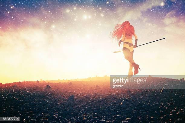 Lone female fantasy warrior walking into sunset