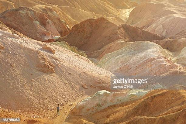 lone female in colourful landscape - great basin stock pictures, royalty-free photos & images