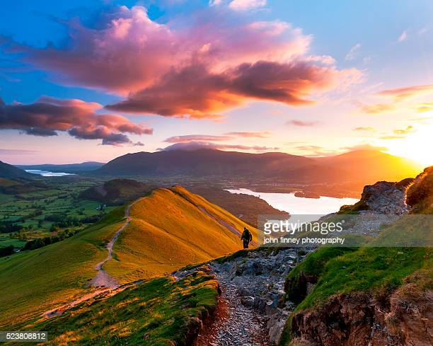 Lone figure, Mountain sunrise. Lake District National park. UK.