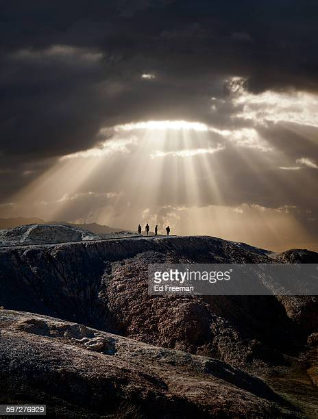 lone figures, mountain, dramatic sky - dieu photos et images de collection