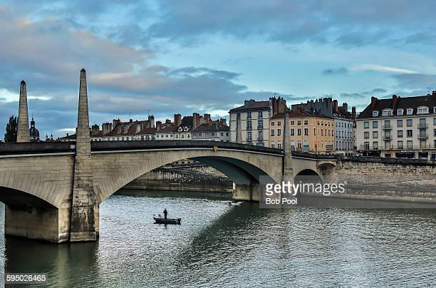 lone fisherman, saone river bridge - シャロンシュルソーヌ ストックフォトと画像