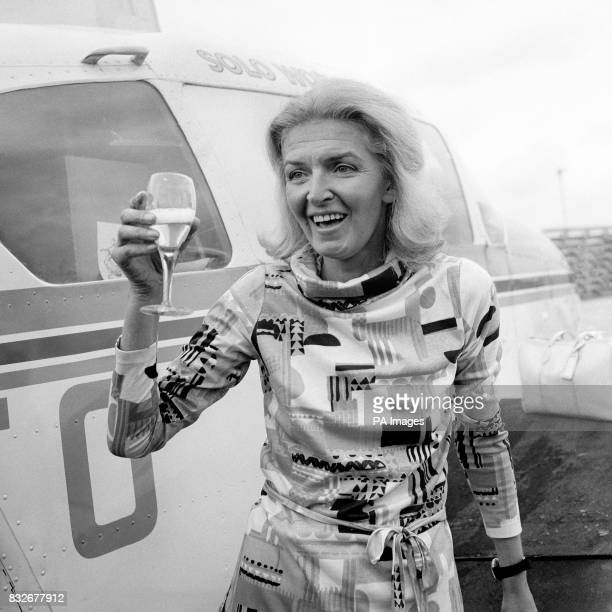 Lone flyer Sheila Scott enjoying a wellearned drink after arrival at Heathrow She claimed her 100th air record for the last stage of her marathon...
