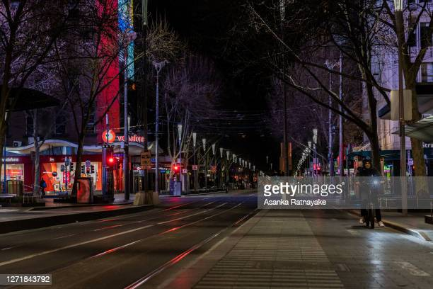 Lone food delivery rider is seen travelling along a deserted Swanston Street during curfew on September 10, 2020 in Melbourne, Australia. Melbourne...
