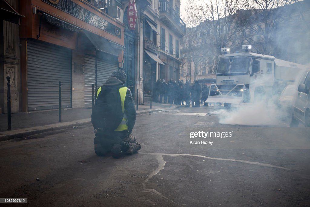 A Lone Gilets Jaunes Protestor Makes A Silent Protest To The News