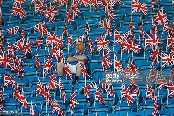 A lone Glasgow Rangers fan sits amongst empty seats and British Union Jack flags before the UEFA Cup Final between FC Zenit St Petersburg and Rangers...