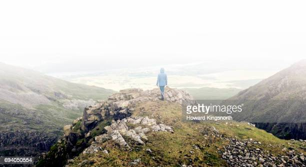 Lone hiker contemplating scenic mountain view