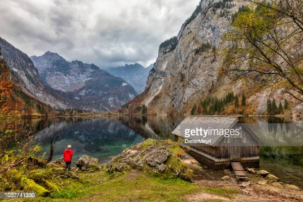 lone hiker in bavaria berchtesgaden obersee koenigssee - alps - königssee bavaria stock photos and pictures