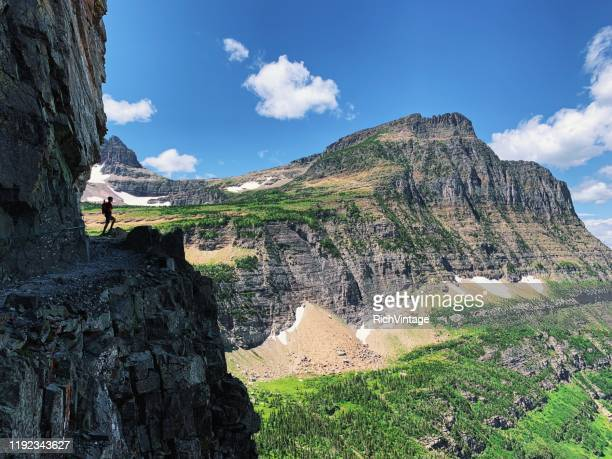 lone hiker in glacier national park - glacier national park stock pictures, royalty-free photos & images