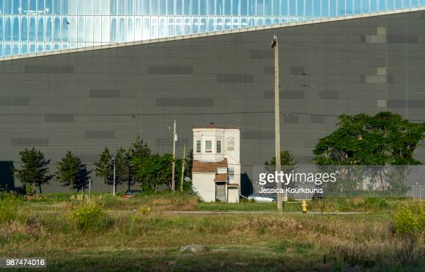 A lone house is dwarfed by an outside wall of the former Revel casino reopened on this week as the Ocean Resort on June 28 2018 in Atlantic City New...