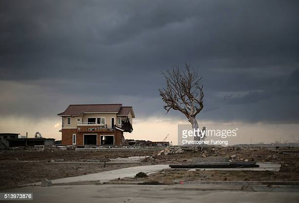 Lone house sits on the scarred landscape, inside the exclusion zone, close to the devastated Fukushima Daiichi Nuclear Power Plant on February 26,...