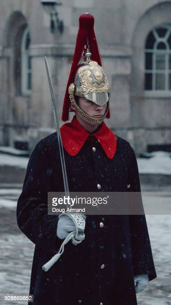 LONDON,UNITED KINGDOM - 2ND MARCH 2018: A lone Household Cavalry Guard stands in light falling snow, London, UK
