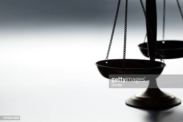 Lone justice scale on simple gray background