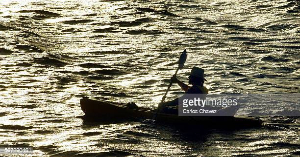 Lone kayaker Howard Gross enjoys Castaic Lake in warm late afternoon light Monday March 10 2002