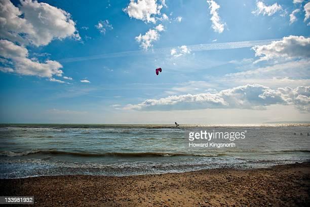lone kitesurfer - newpremiumuk stock pictures, royalty-free photos & images