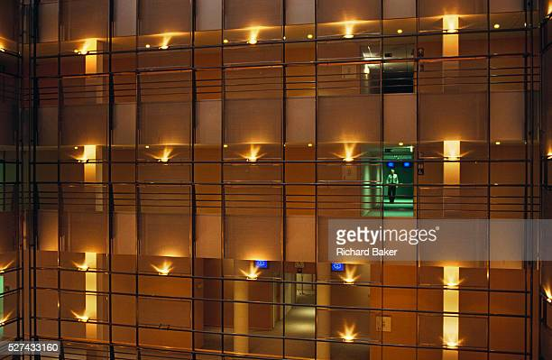 A lone male figure makes his way along a corridor of power in the newlyopened European Parliament building in Brussels Belgium As the new...
