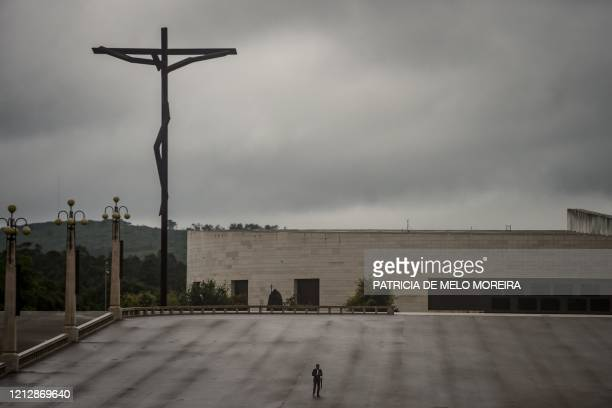 Lone man stands at the Fatima sanctuary during the 103rd anniversary of the apparitions of Our Lady Fatima in central Portugal on May 13, 2020. -...