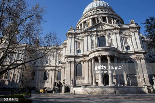 Lone man walks past St Pauls Cathedral. March 24th 2020 was the first day of enforced lockdown in the UK, in order to stop the spread of the...