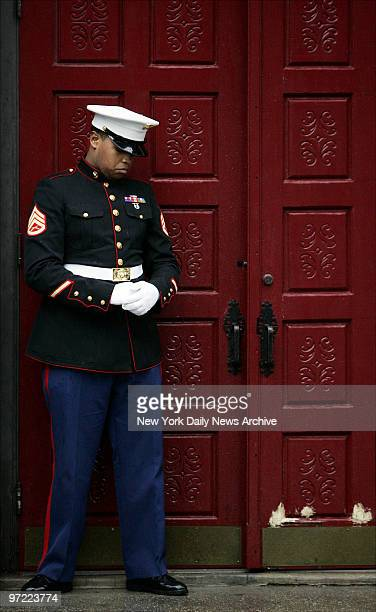 A lone Marine stands his post at the door of St Mary's Church on Grand St where the funeral service for Nixzmary Brown was being held The 7yearold...