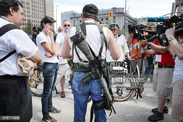 A lone member of a group supporting the carrying of weapons openly speaks to the media at what was supposed to be a march ahead of the Republican...