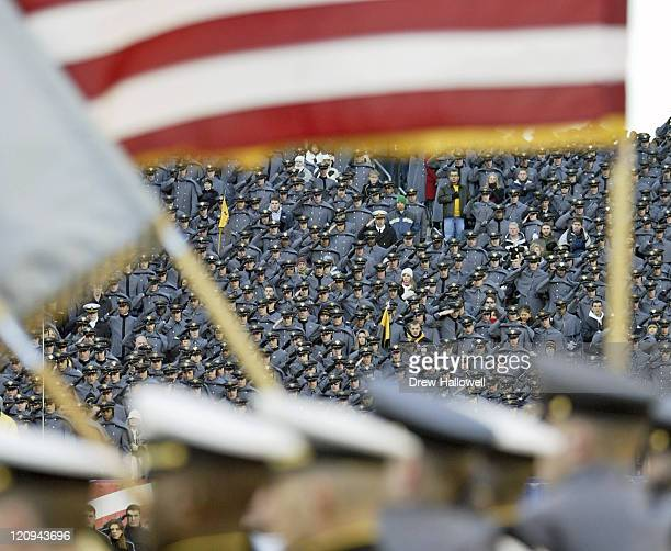 A lone Navy Midshipmen stands in a sea of Army Cadets Saturday December 3 2005 at Lincoln Financial Field in Philadelphia PA