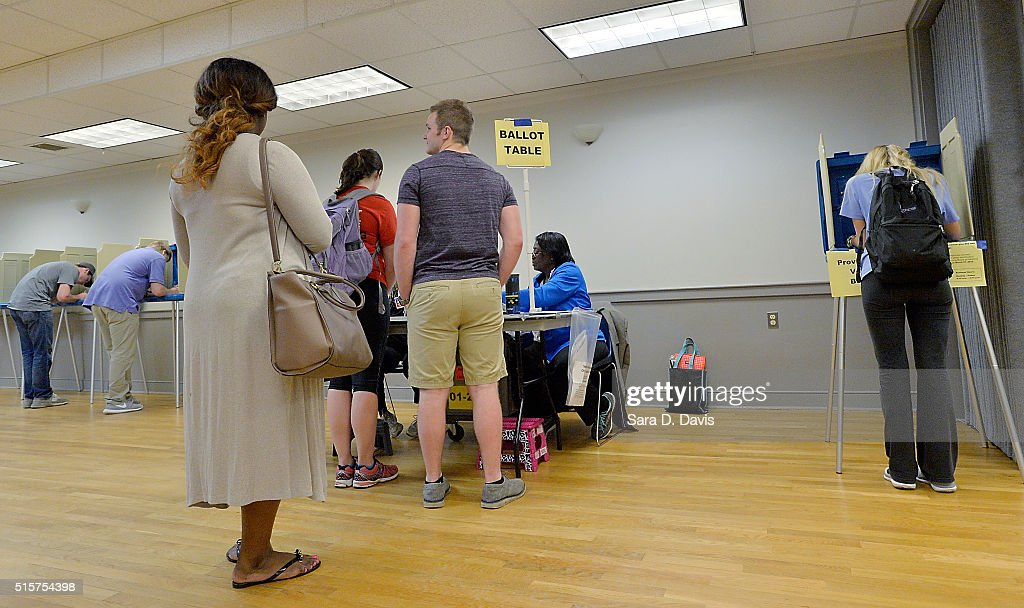 A lone North Carolina State University student, right, votes in the primaries at the provisional ballot booth at Pullen Community Center on March 15, 2016 in Raleigh, North Carolina. The North Carolina primaries is the state's first use of the voter ID law, which excludes student ID cards. Wake County was among the highest use of provisional ballots, where those voters had home addresses on or near campuses. The Board of Elections will review voter's reasonable impediment form submitted with their provisional ballots to determine if their vote counts. The state's voter ID law is still being argued in federal court.