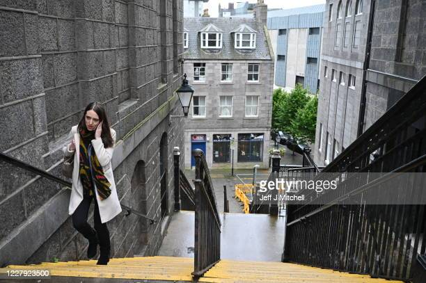 A lone pedestrian walks up stairs on August 5 2020 in Aberdeen Scotland Scotland's First Minister Nicola Sturgeon acted swiftly and put Aberdeen back...