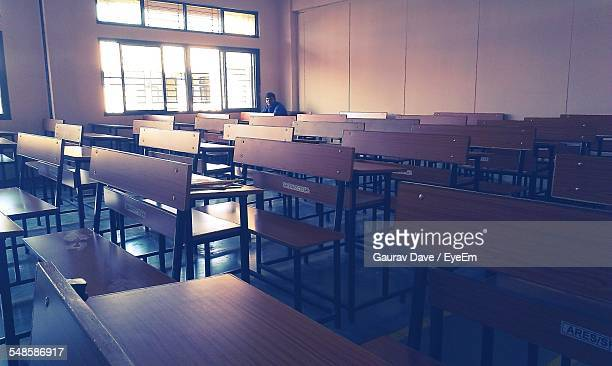 Lone Person Sitting In Classroom