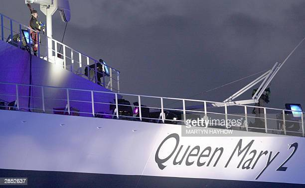 A lone piper on the Queen Mary 2 Cruise liner at Southampton 8 January 2004 during the naming ceremony by Britain's Queen Elizabeth II The GBP550...
