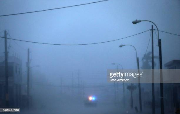 A lone police car on patrol during the passing of Hurricane Irma on September 6 2017 in Fajardo Puerto Rico The category 5 storm is expected to pass...