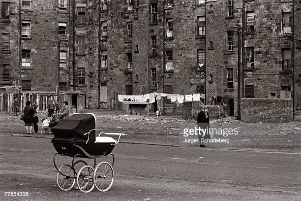 A lone pram beside a road in the Gorbals area of Glasgow 1968