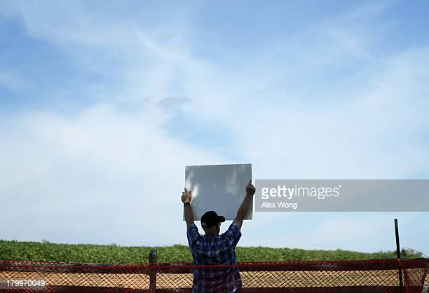 A lone protester holds up a poster against a rally by members of the Confederate White Knights at the Antietam National Battlefield September 7 2013...