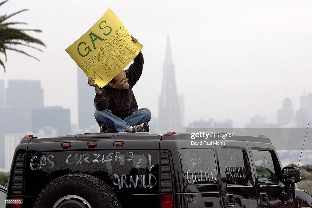 A lone protester sits on top of a Hummer just before California Governor Arnold Schwarzenegger signs the landmark legislation bill AB-32, the California Global Warming Solutions Act of 2006 September 27, 2006 on Treasure Island in San Francisco, California. Schwarzenegger was joined by New York Governor George Pataki, and British Prime Minister Tony Blair via satellite along with other international leaders with a consistent record of addressing the global threat of climate change and other environmental and industry leaders.
