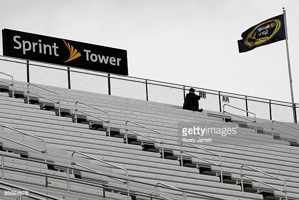 A lone race fan braves the cool wet weather to watch NASCAR Sprint Cup practice during practice for the NASCAR Sprint Cup Series Goody�s Fast Pain...