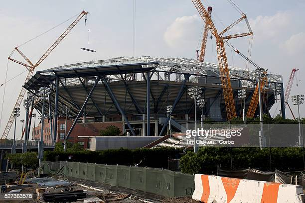 A lone racket rises amongst the construction site as tennis still takes place on the outer courts despite the massive construction operation at...