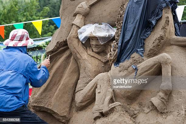 Lone Ranger sand sculpture being created