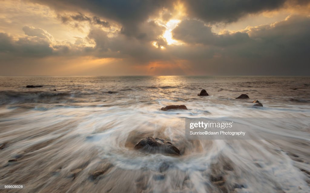 Lone Rock, White Waves and Golden Sunset : Stock-Foto
