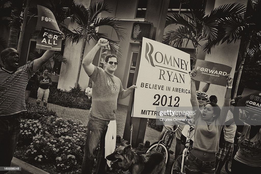 A lone Romney supporter during an Obama campaign rally at the Delray Beach Tennis Center on October 23, 2012 in Delray Beach, Florida. Obama continues to campaign across the U.S. in the run-up to the November 6, presidential election.