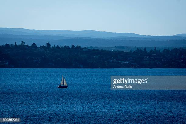 lone sailboat on a lake - cordoba argentina stock photos and pictures